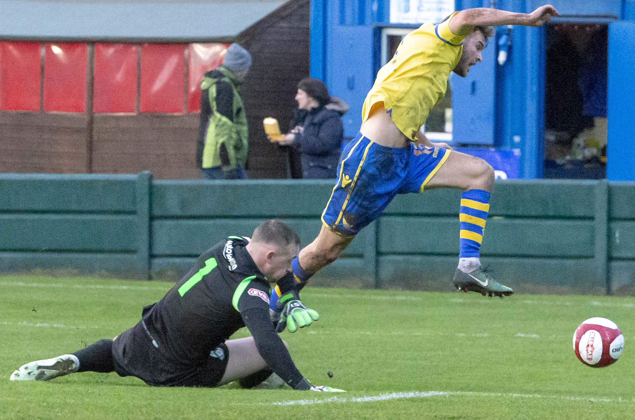 Jake Kirby is felled for the penalty that gave Yellows the lead. Picture