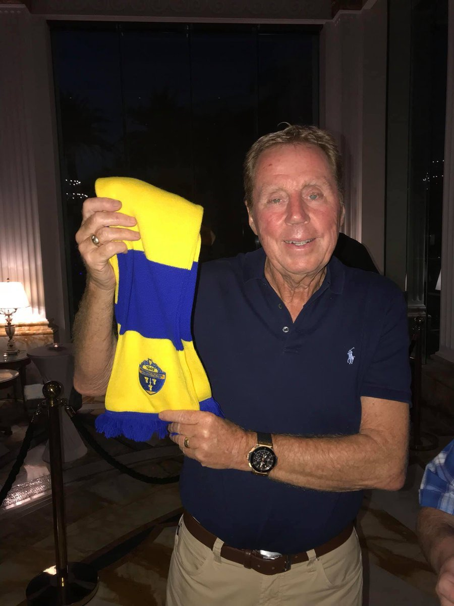 Harry Redknapp happily poses with a Warrington Town scarf. Picture by Jay Rae