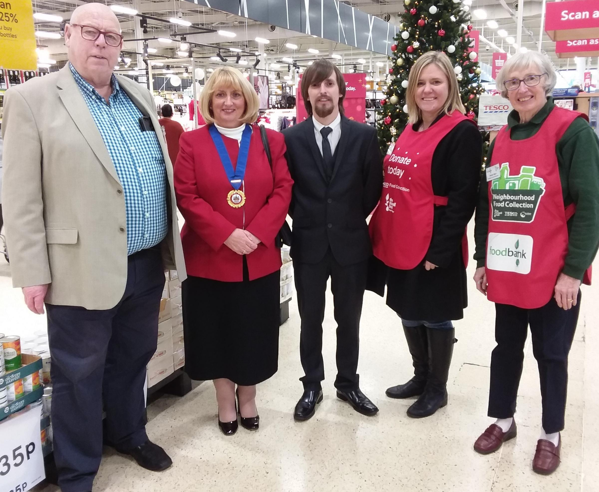 Warrington Foodbank project manager David McDonald with the Mayor of Warrington Cllr Karen Mundry, her consort Jason Mundry and volunteers Sarah Lavelle and Sheila Warr