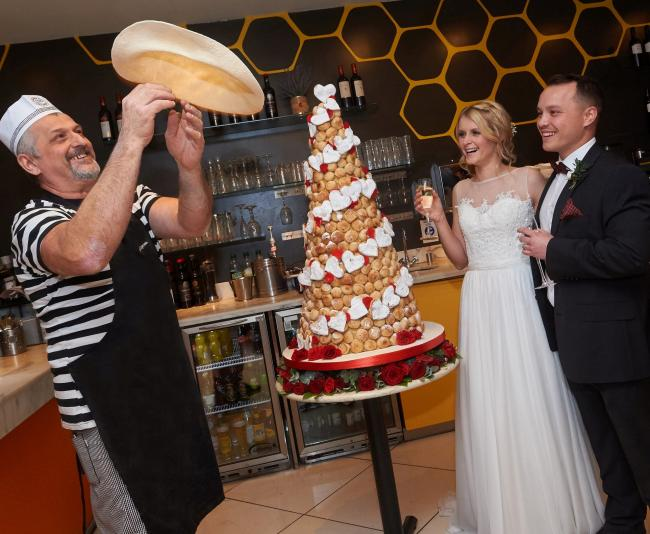 Maddie Jones, 29 and Alex Sung, 30 during their wedding at Pizza Express. Pic credit: SWNS