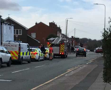 Armed police swooped on Prescott Road in Golborne.