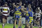 Jack Hughes looks delighted with th game's final try for Warrington Wolves against Wigan Warriors. Picture: Mike Boden