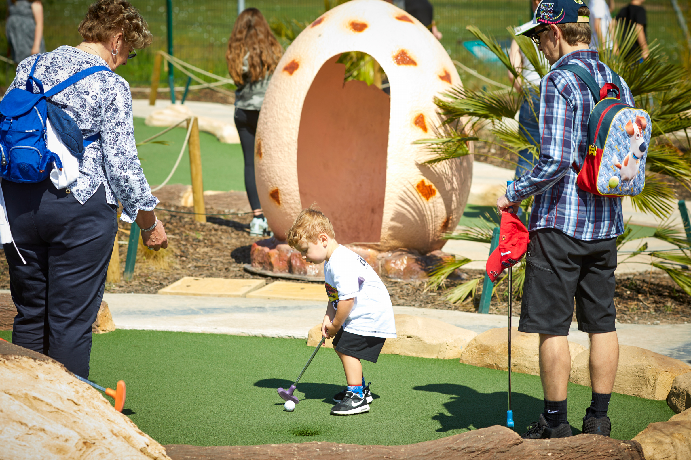 Kids can go FREE at Dino Falls Adventure Golf this April