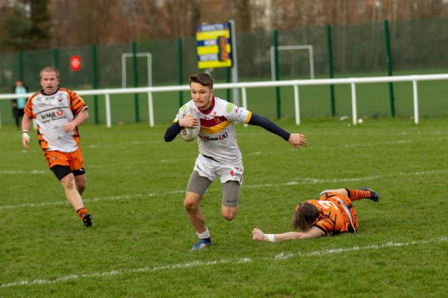 Alex Davies on his way to scoring for Latchford Albion against Widnes Tigers. Picture by Stephen Speakman