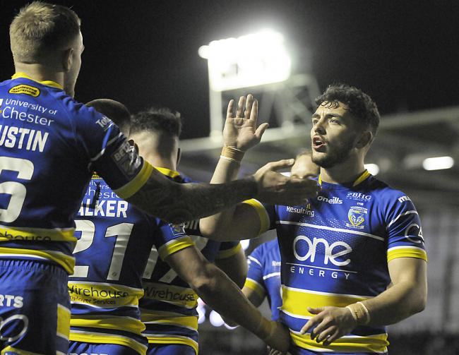 Declan Patton and Blake Austin celebrate during Warrington Wolves' win over London Broncos at the Halliwell Jones Stadium.