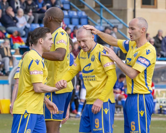 Yellows celebrate Tony Gray's goal at Matlock. Picture by John Hopkins