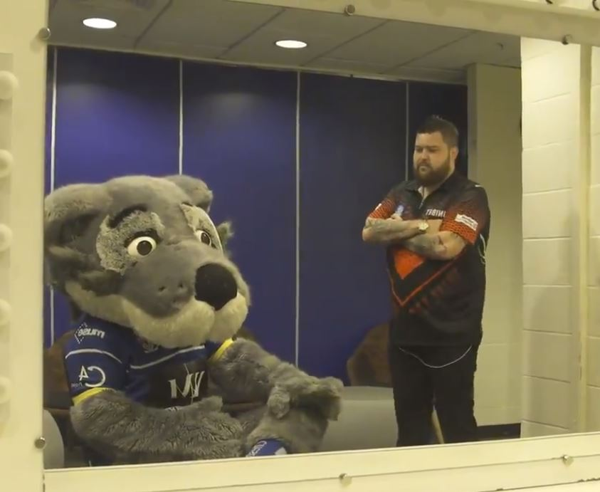 Darts star and St Helens fan Michael Smith was far from pleased to see Wolfie in his dressing room