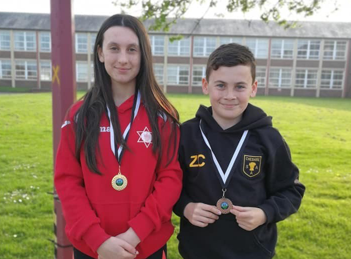 Olivia Chamun and brother Zak with their medals from the Deeside Open