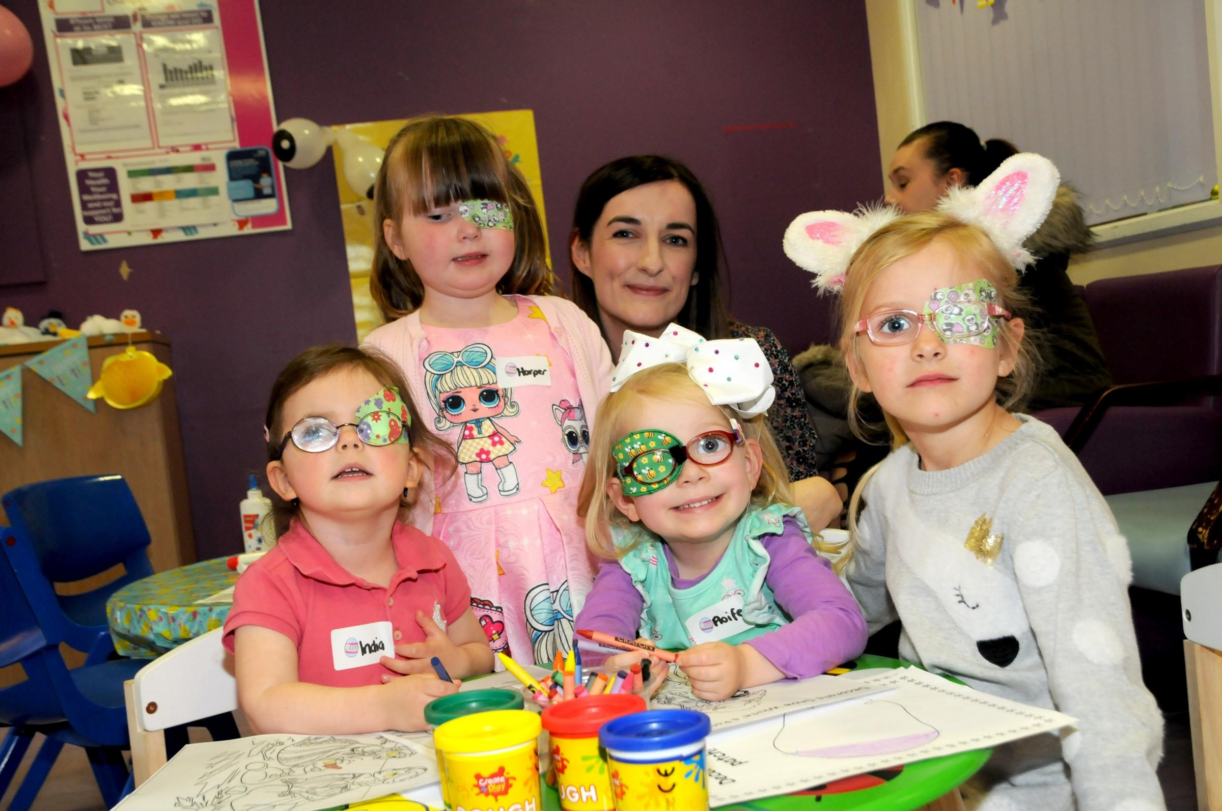 Left, India Carman aged two, Harper Hanley aged four, Jennifer Shave, specialist orthoptist, Aoife McNamara aged three and Lucy Welsby aged five