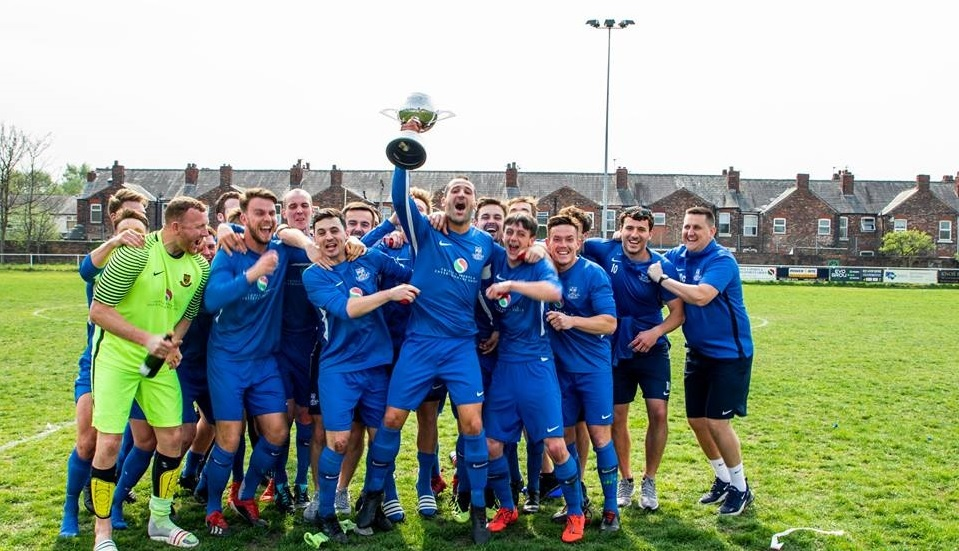 Wild celebrations at Gorsey Lane as Rylands skipper Gary Kenny holds the league title aloft. Picture by Lee Wolstencroft