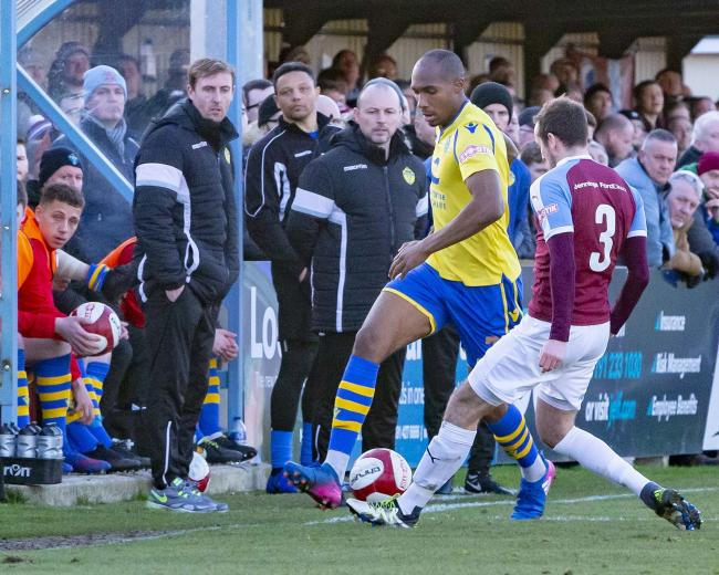 Yellows boss Paul Carden watches Bohan Dixon take on a South Shields defender on their last visit in February. Picture by John Hopkins