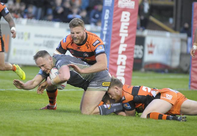 Ben Currie gets close to the line in the Warrington Wolves win against Castleford Tigers. Picture: Mike Boden