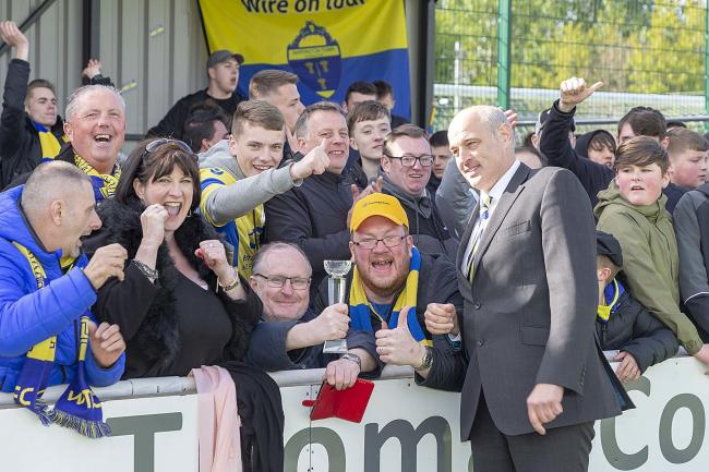 Toby Macormac celebrates Yellows' win at South Shields with supporters. Picture by John Hopkins
