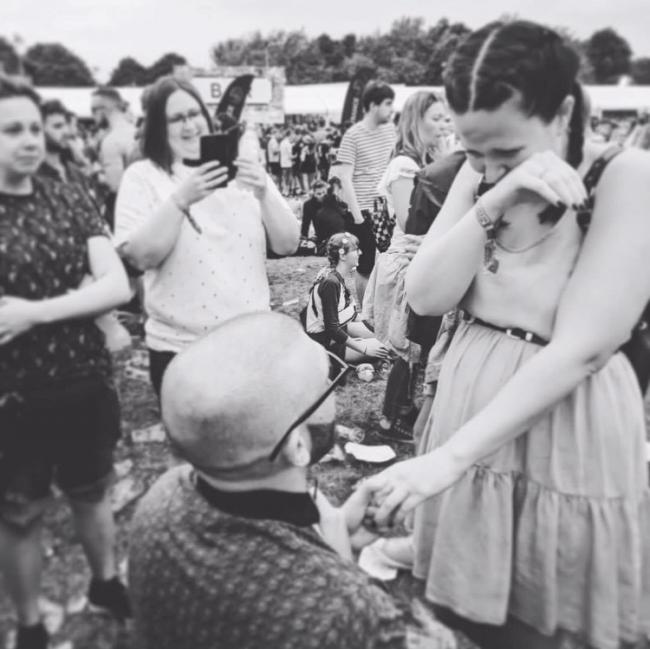 Ross Dryden proposes to Lindsey Travis at the 2018 Neighbourhood Weekender in Victoria Park.
