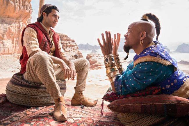Mena Massoud as Aladdin and Will Smith as Genie