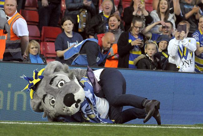 Wolfie is decked by a Steve Price spear tackle at Anfield. Picture: Mike Boden